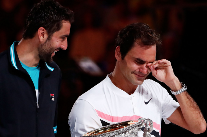 Marin Cilic (left) with Roger Federer (right) after his victory