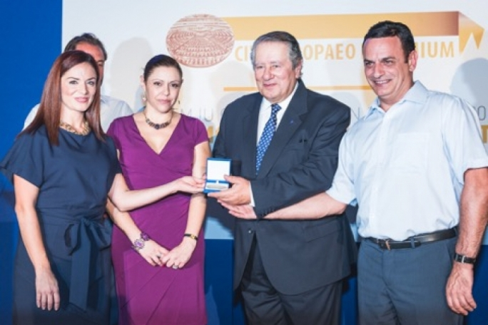 MEPs Miriam Dalli and David Casa present the prize to Richmond chairman Victor Guillaumier