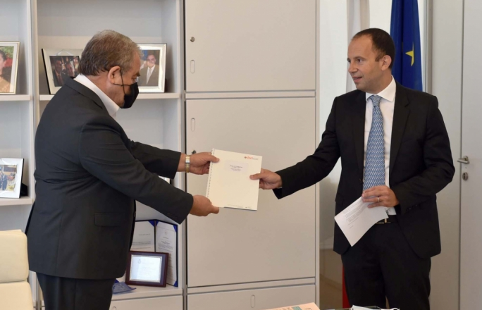 Claudio Grech (right) presents Speaker Anglu Farrugia with a copy of the Save A Life Foundation annual report
