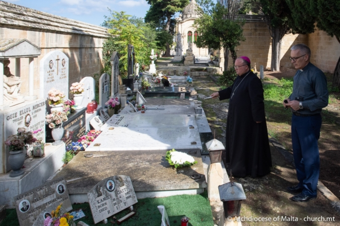 Archbishop Charles Scicluna blesses the grave of Labour politician Guze Ellul Mercer