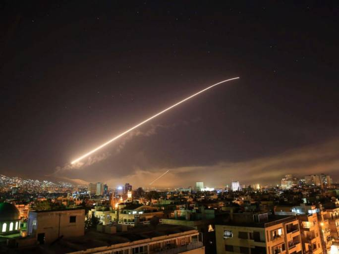 One of the missile attacks lights up the Damascus sky as it hits targets related to suspected chemical attacks by the Assad government