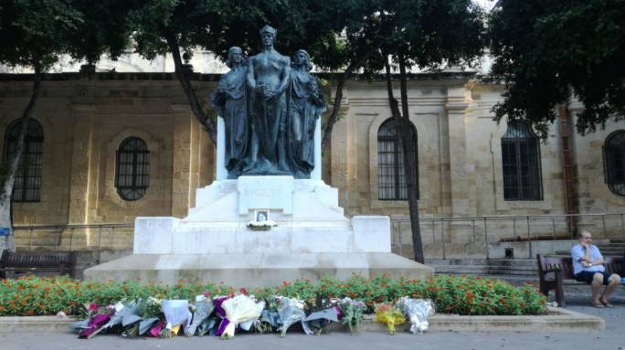 Flowers for Daphne Caruana Galizia at the foot of the Great Siege monument in Valletta