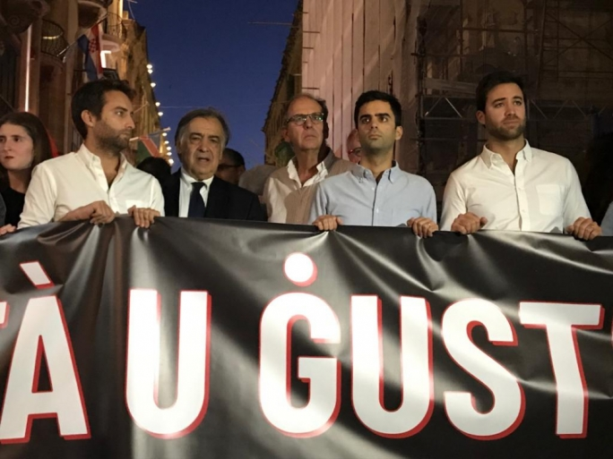 Daphne Caruana Galizia's sons and widower alongside Palermo mayor Leoluca Orlando (second left) in one of the demonstrations calling for justice