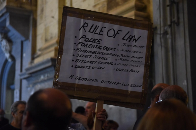 Activists called on the authorities to find the people behind Caruana Galizia's murder. (Photo: James Bianchi/MediaToday)