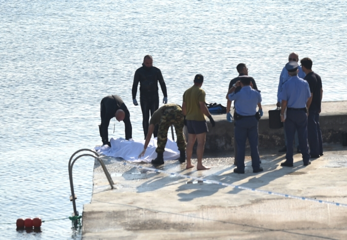 The police retrieving the dead man's body in St Paul's bay. Photo by Ray Attard