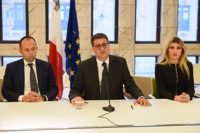 PN leader Adrian Delia (centre) flanked by Claudio Grech and Kristy Debono