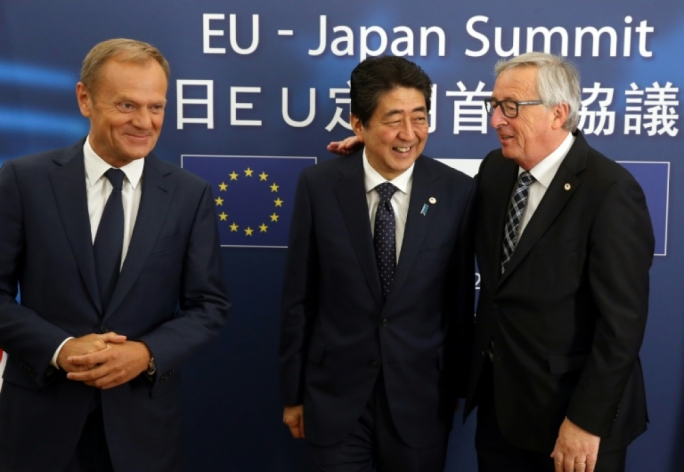 EU President Donald Tusk (left), Japanese Prime Minister Shinzo Abe (centre) and European Commission chief Jean-Claude Juncker in Brussels