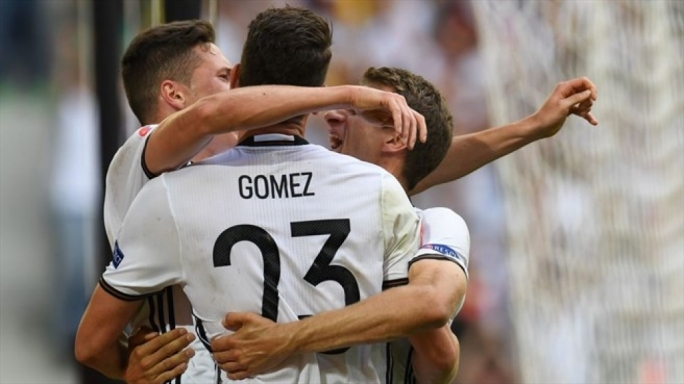 Mario Gómez  of Germany celebrateing with Julian Draxler and Thomas Müller after scoring their second goal during their UEFA EURO 2016 round of 16 match against Slovakia