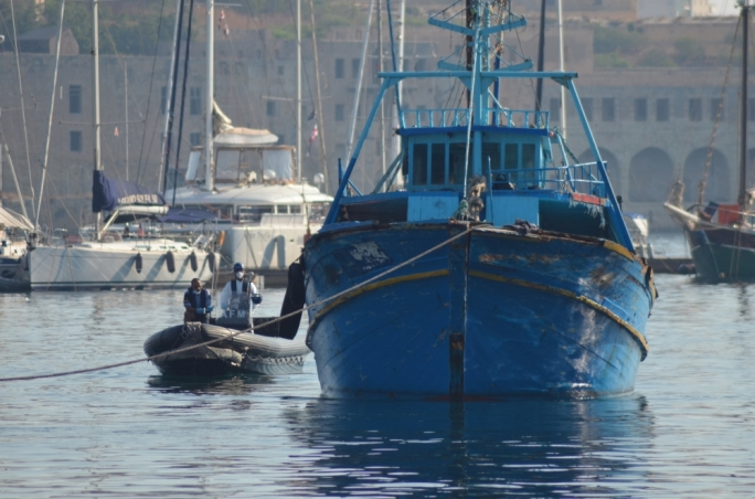 The migrants' board was towed to Malta