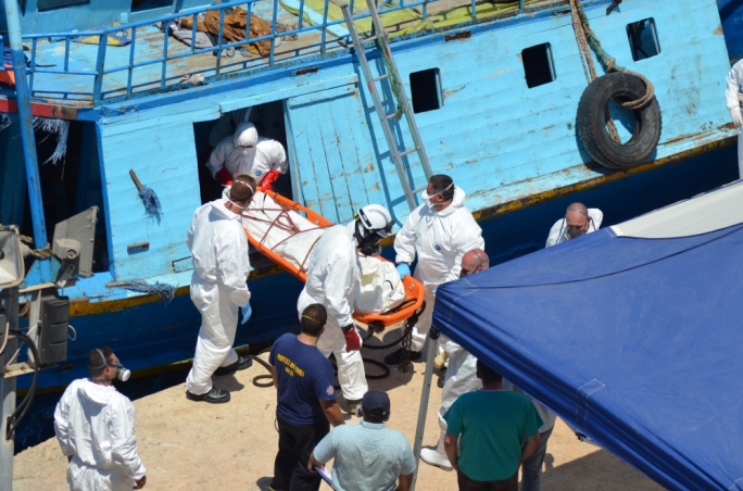 The first body recovered from the migrants' boat (All photos by John Pisani)