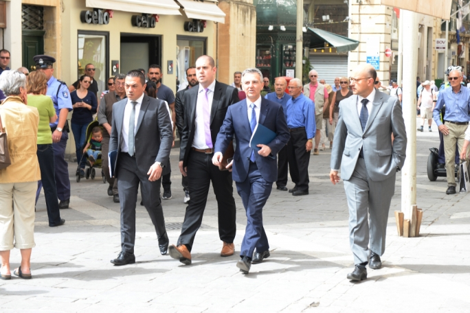 Simon Busuttil (second from right) arriving at Court this morning to appear before inquiring magistrate