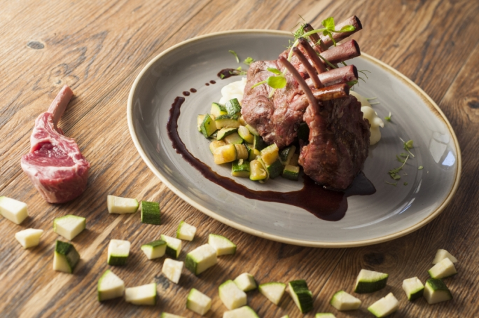 Rack of lamb, zucchini and fennel soffritto with thyme infused lamb jus