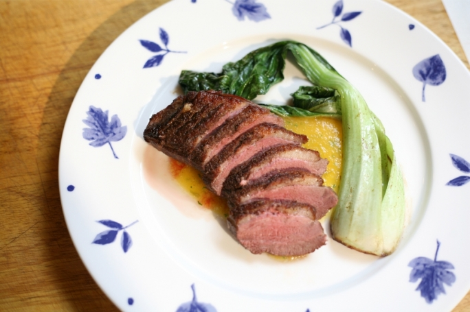 Seared duck breast, with apricot relish and bok choy