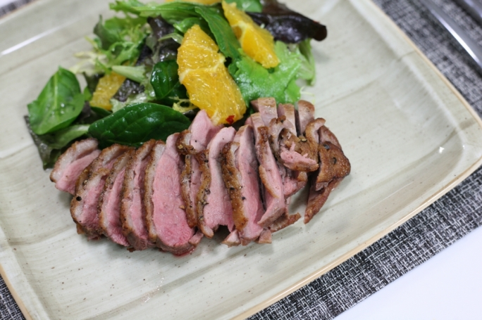 Duck breast with an orange and spinach salad