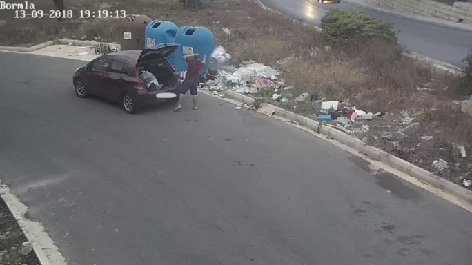 Caught in the act: man dumps waste illegally outside the bins