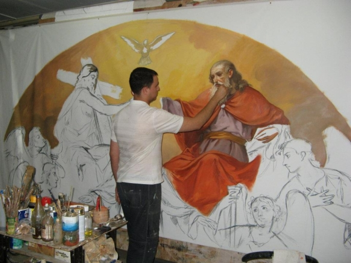 Manuel Farrugia while painting one of his works featured in the parish church of St. Paul's Bay