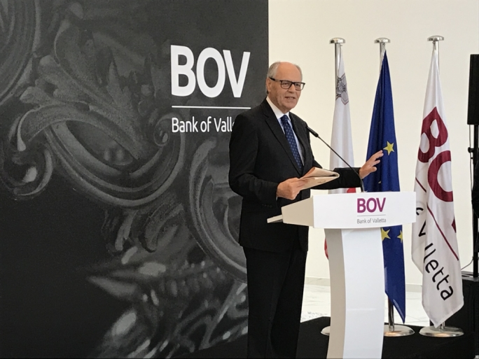 Edward Scicluna holding the FT while inaugurating the new BOV offices