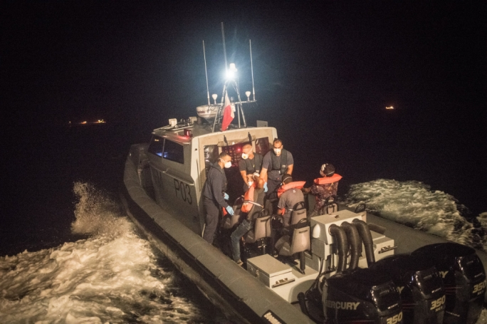 AFM evacuating three migrants' from the Alan Kurdi, credit Sea-Eye