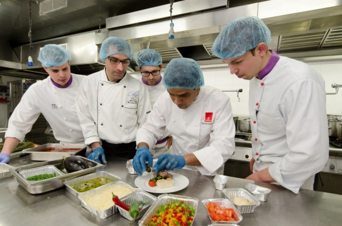 Ravi Nage (second from right) explaining the plating details. Emirates believes that every meal should relax and restore as much as satisfy the passenger's appetite