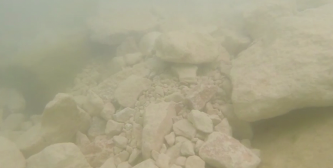 A still from footage showing construction waste from Esplora that was allegedly dumped in nearby waters