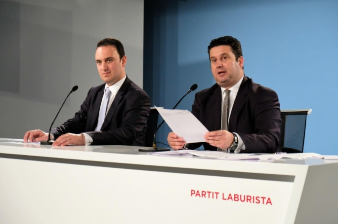 Labour MP Clifton Grima and tourism minister Edward Zammit Lewis address a press conference