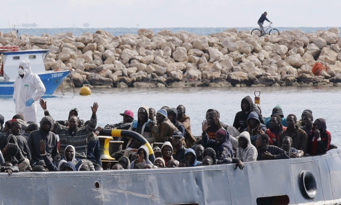 (File Photo) Migrants arrive in the Sicilian port of Pozzallo after being rescued off the coast of Lampedusa