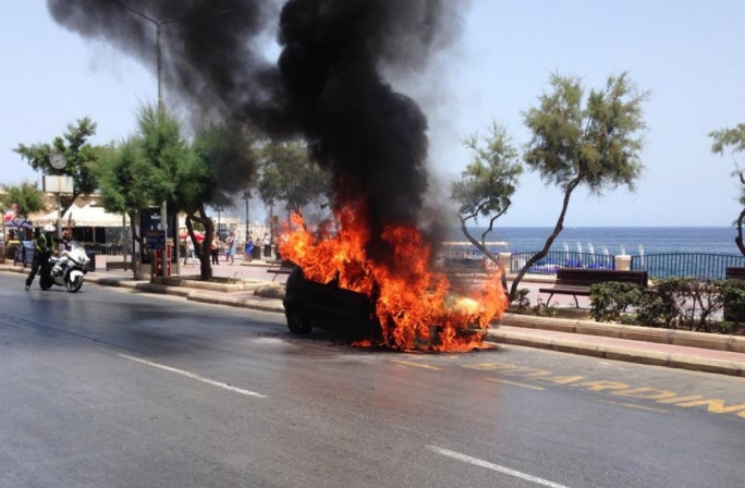 Flames engulfed a car in Sliema.