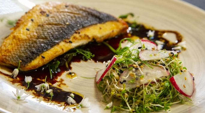 Sea bass with stir fried pea shoots & cress salad
