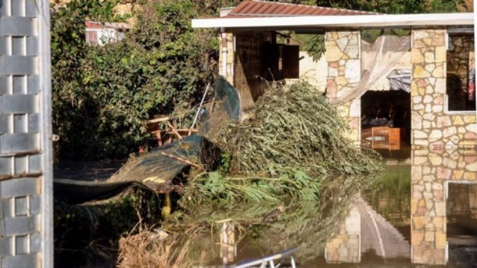 The home where the flooding took place, leaving two families dead (Source: AFP)