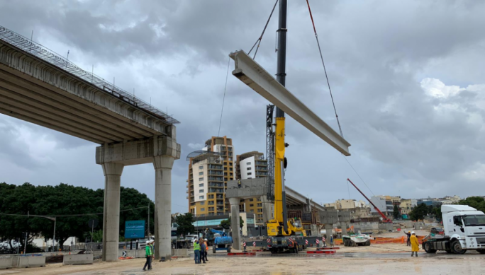 The placing of beams for the third flyover started on Saturday morning