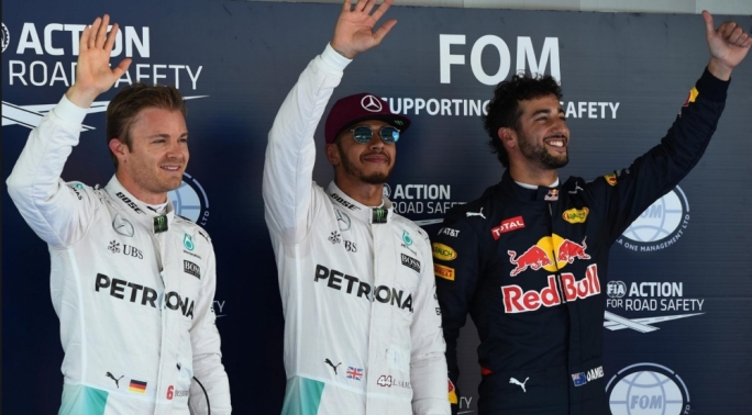 (L to R): Nico Rosberg (GER) Mercedes AMG F1, pole sitter Lewis Hamilton (GBR) Mercedes AMG F1 and Daniel Ricciardo (AUS) Red Bull Racing celebrate in parc ferme