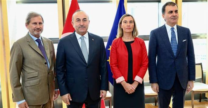 European Commissioner in charge of European neighbourhood policy and enlargement negotiations Johannes Hahn, Turkish foreign minister Mevlut Cavusoglu, European Union foreign policy chief Federica Mogherini and Turkish minister for EU affairs Omer Celik
