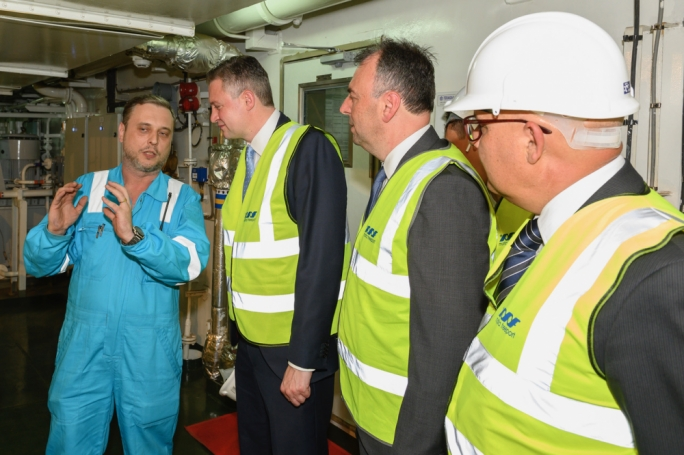 Tourism Minister Konrad Mizzi (second from left) and Malta Freeport Terminals CEO Alex Montebello (third from left) being given a tour of the first LNG-powered container ship to visit Malta