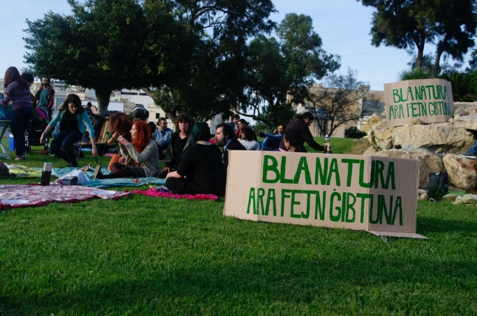 Activists held the picnic on roundabouts next to a slogan reading 'Without nature, look where we've ended up'.