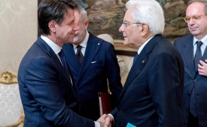 Giuseppe Conte (left) presented a new list of ministers to President Sergio Mattarella