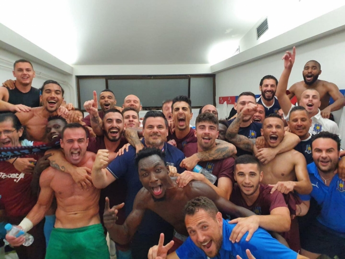 The Gżira United clan celebrating victory in the dressing room (Photo: Gżira Utd/Facebook)