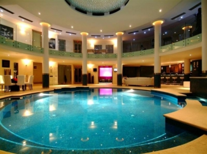 Relax... there's an indoor pool inside Hugo's mansion