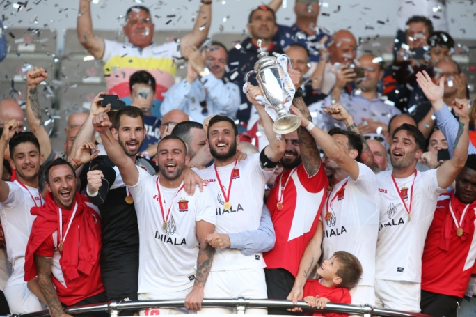 Valletta's players celebrating their triumph. Photo: Christine Borg