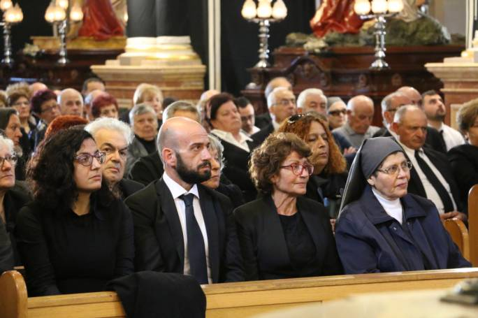 Charles Miceli's wife, Pauline (2nd from right) and daughter Vanessa (4th from right), were joined by many more people in paying their last respects