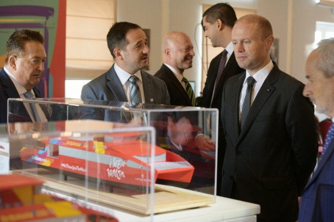 Fortina Investments CEO Edward Zammit Tabona (centre) with Prime Minister Joseph Muscat
