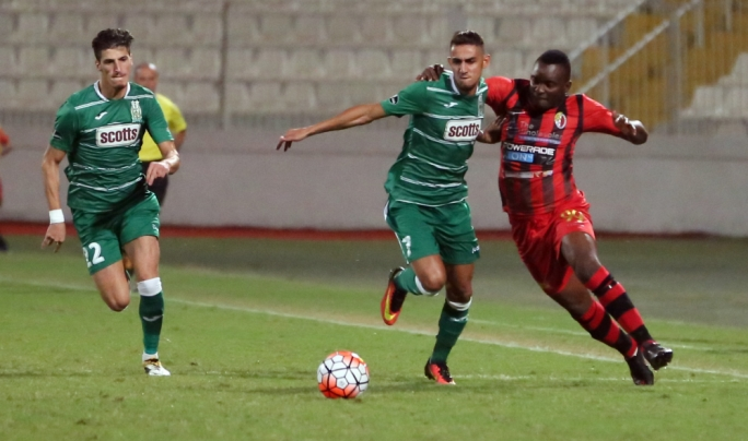 Floriana's Steve Pisani and Saturday Nanapere of Ħamrun challenging each other for the ball. Photo: Dominic Borg
