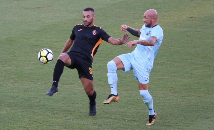 Thomas Veronese of Gżira challenging Karl Micallef for the ball. Photo: Christine Borg