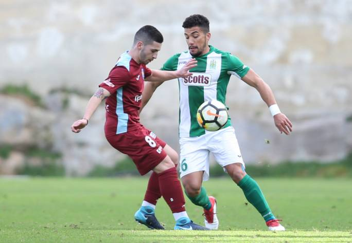 Zack Scerri of Gżira and Arthur Oyama challenging each other for the ball. Photo: Christine Borg