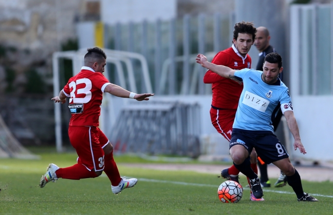 Triston Caruana of Tarxien challenging Mark Scerri for the ball. Photo: Christine Borg