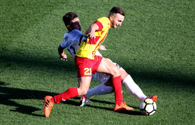 Thiago Espindola De Paula of Ħamrun tackling Ryan Scicluna for the ball. Photo: Dominic Borg