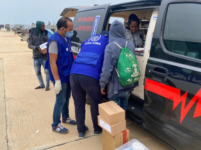 An IOM photo of the returned asylum seekers in Libya during which seven people perished at sea after the pushback from Malta