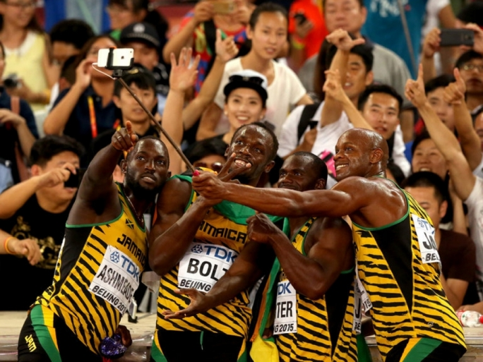 Usain Bolt and a delighted Jamaican relay team