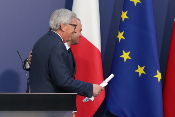 Jean-Claude Juncker (left) being escorted by the Prime Minister