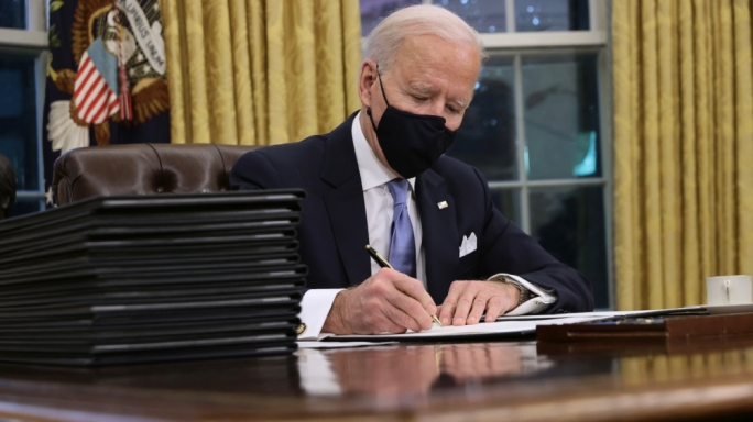 Biden signs executive orders reversing Trump policies on the border wall, Paris Climate Accords