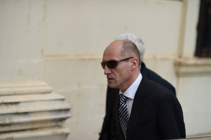 File photo of Jonathan Ferris accompanying OLAF head Giovanni Kessler to a Maltese court in the case against Silvio Zammit